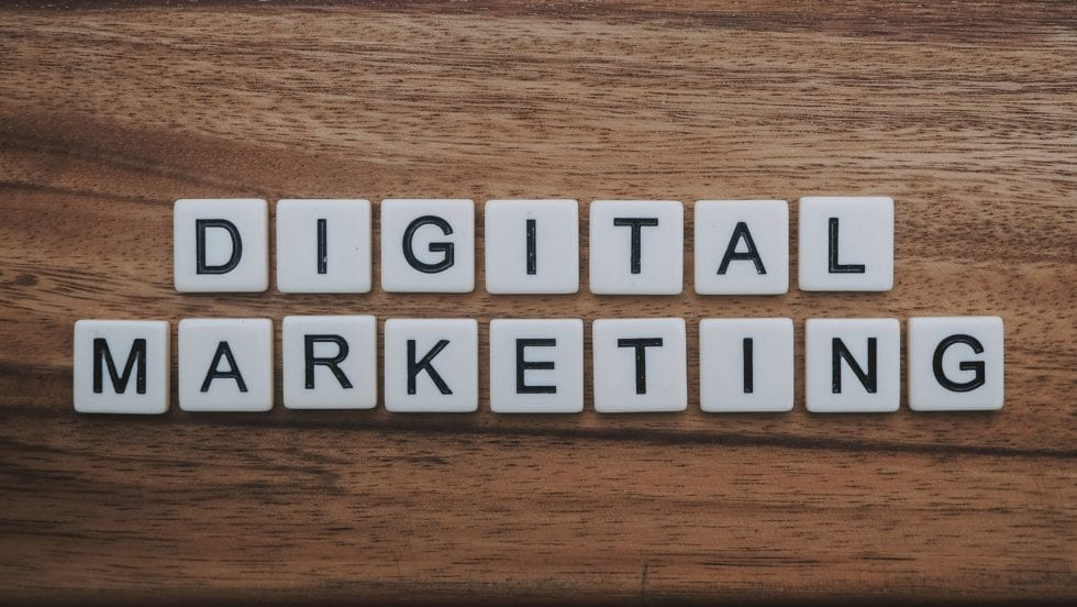 Digital Marketing laid out on a table in scrabble pieces.